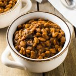 With a few simple ingredients and time, you can make a delicious, slow cooked New England baked beans dinner.
