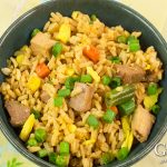 Fried rice is a great recipe to have on hand to re-purpose leftovers so they don't go to waste. This pork fried rice recipe combines leftover pork, rice, and vegetables with a tasty ginger garlic sauce for a dish that will satisfy your craving for takeout.